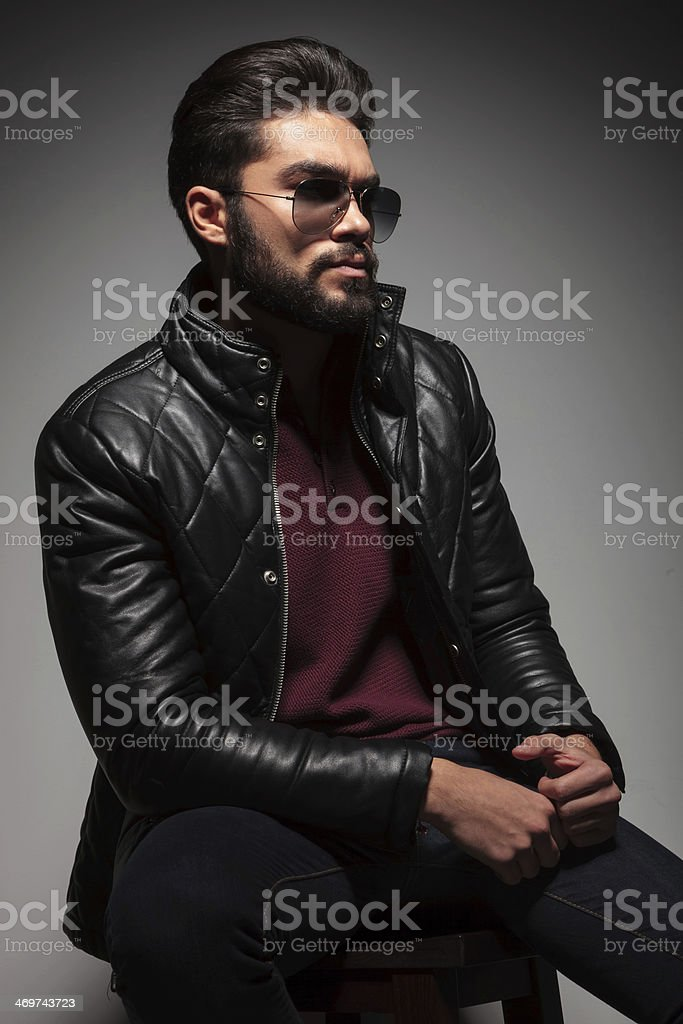 Seated Young Man In Leather Jacket And Sunglasses Stock Photo More