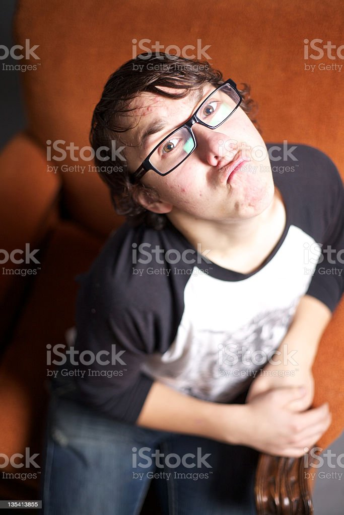 Seated Young Man Makes a Funny Face stock photo