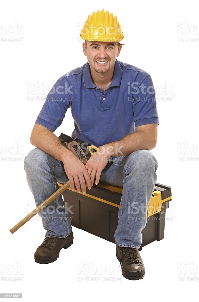 seated young manual worker royalty-free stock photo