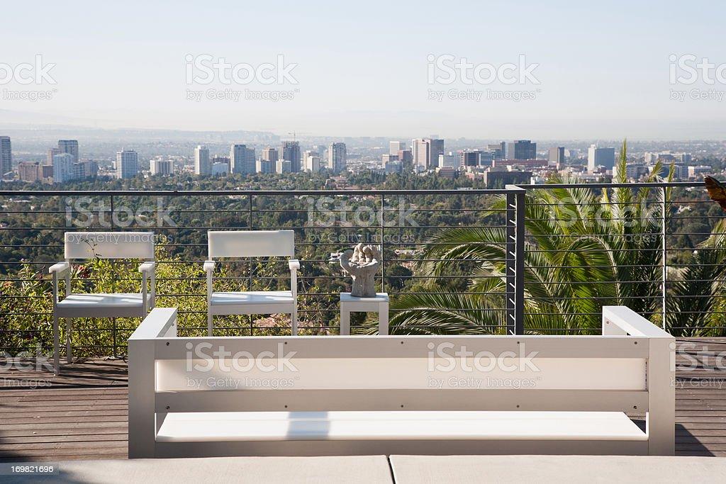 Seating area overlooking cityscape stock photo