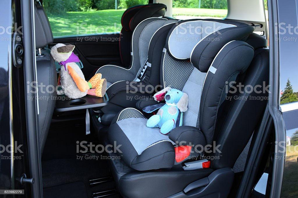 Seats for children in minivan stock photo