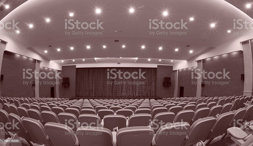 \'seats in an auditorium, black and white.\'
