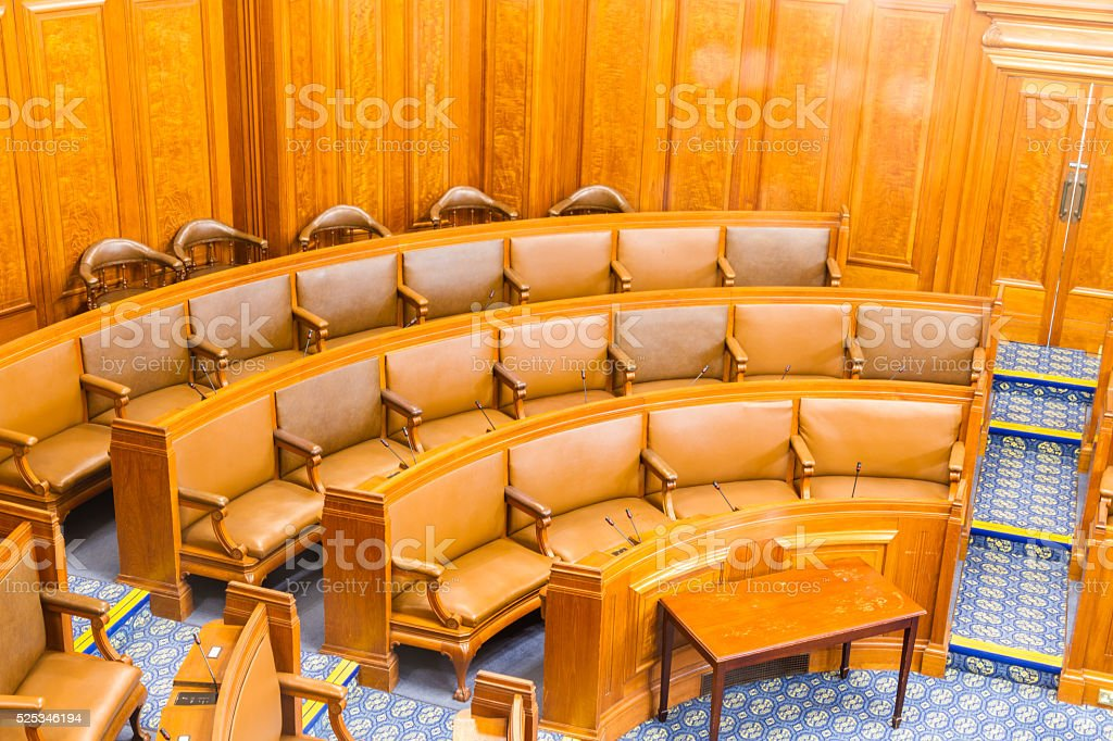 Seats in conference or council chamber. Wood and leather. royalty-free stock photo