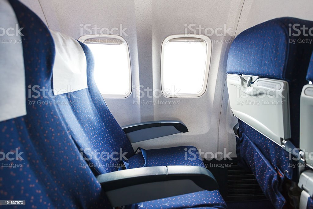 seats in economy class section of airplane stock photo
