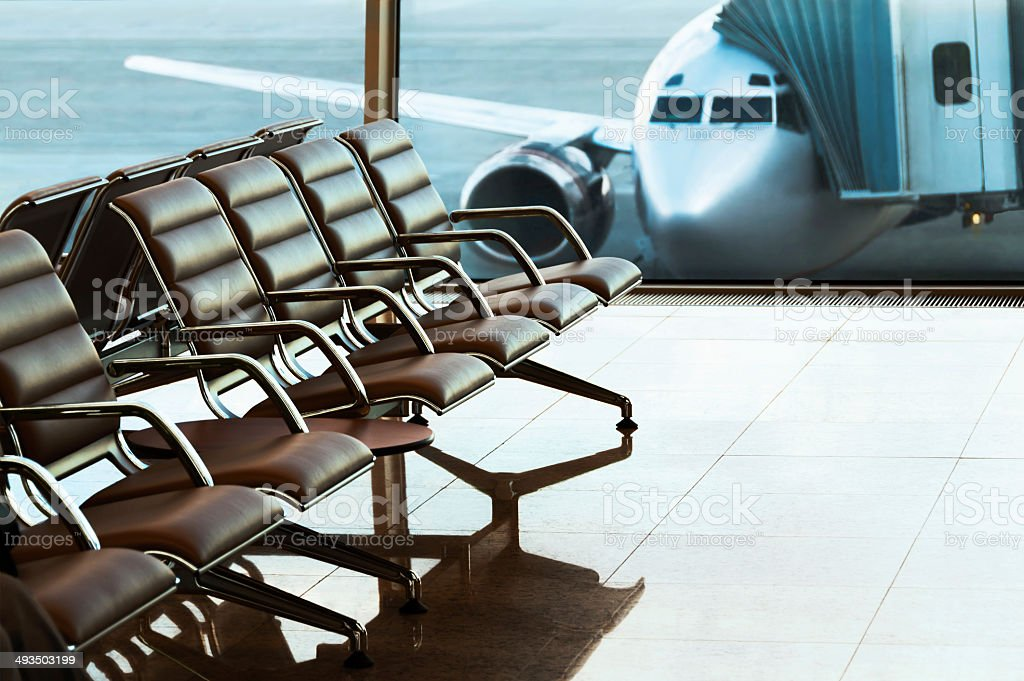 Seats, view from airport hall. Boarding. stock photo