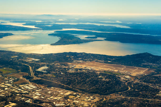 Seattle airport Seattle-Tacoma International Airport from the air with the southern end of Puget Sound in late afternoon light pierce county washington state stock pictures, royalty-free photos & images