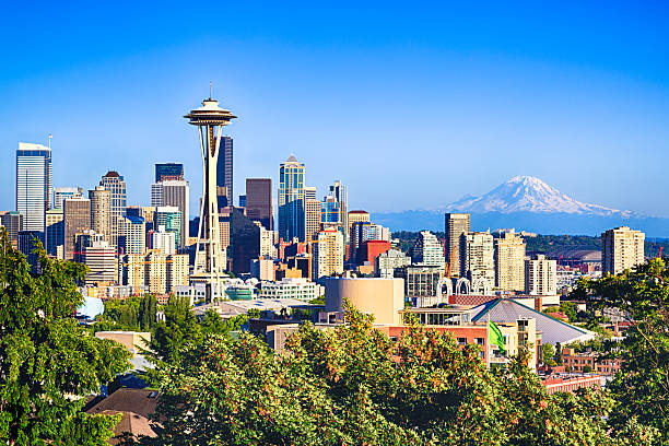 Seattle and Mount Rainier Seattle and Mount Rainier mt rainier stock pictures, royalty-free photos & images