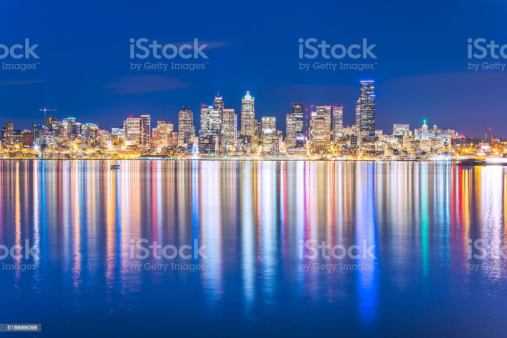 Seattle city in the night time with reflection water stock photo
