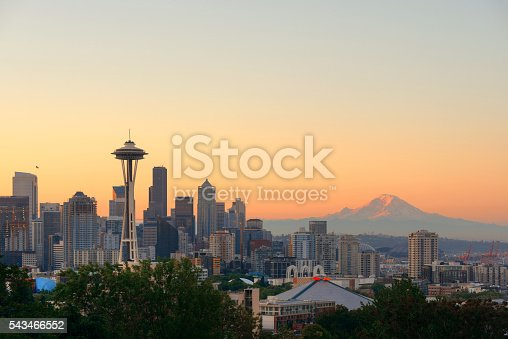 Seattle city skyline with Mt Rainier at sunset with urban office buildings viewed from Kerry Park.