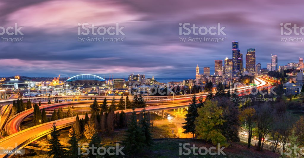 Seattle cityscape at dusk under a dramatic sky stock photo