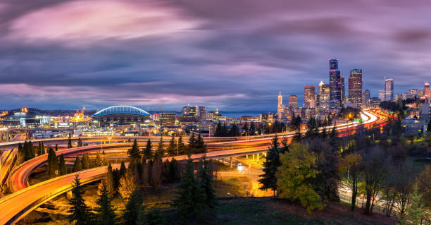 Seattle cityscape at dusk under a dramatic sky