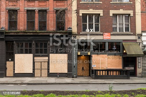 Seattle, USA – March 26, 2020: Late in the day Altstadt restaurant  on 1st in Pioneer Square boarded up and temporarily closed. Seattle has become one of the most affected states from the Covid-19.