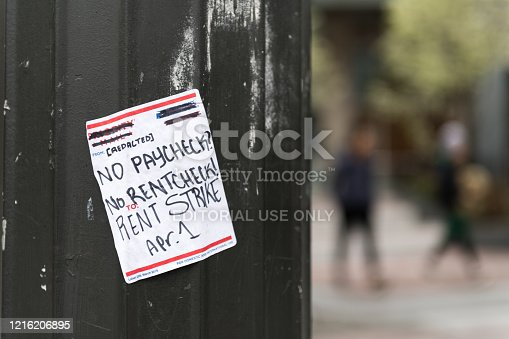 Seattle, USA – March 27, 2020: Late in the day a sticker in Westlake downtown Seattle calling for a rent strike. Seattle has become one of the most affected states from the Covid-19.