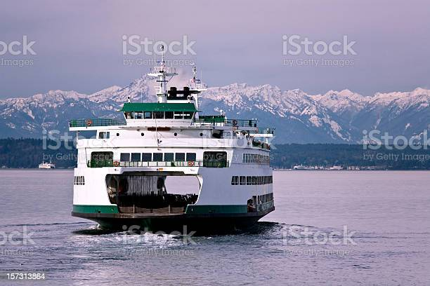 Ferry leaving Seattle on New Year's Day, heading for Bainbridge Island.  Olympic Mountains in background.  Early morning light.