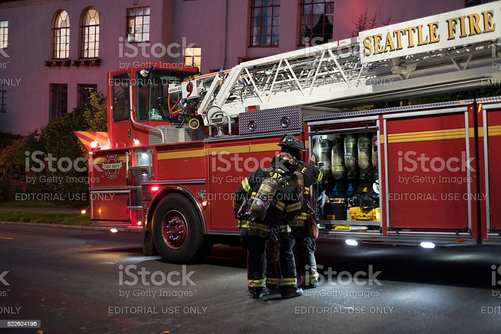 Seattle Fire Department Firefighters Unload The Firehose