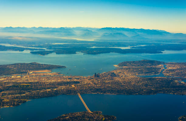Seattle from air Aerial view of Seattle, Puget Sound, and the Olympic range to the west puget sound stock pictures, royalty-free photos & images