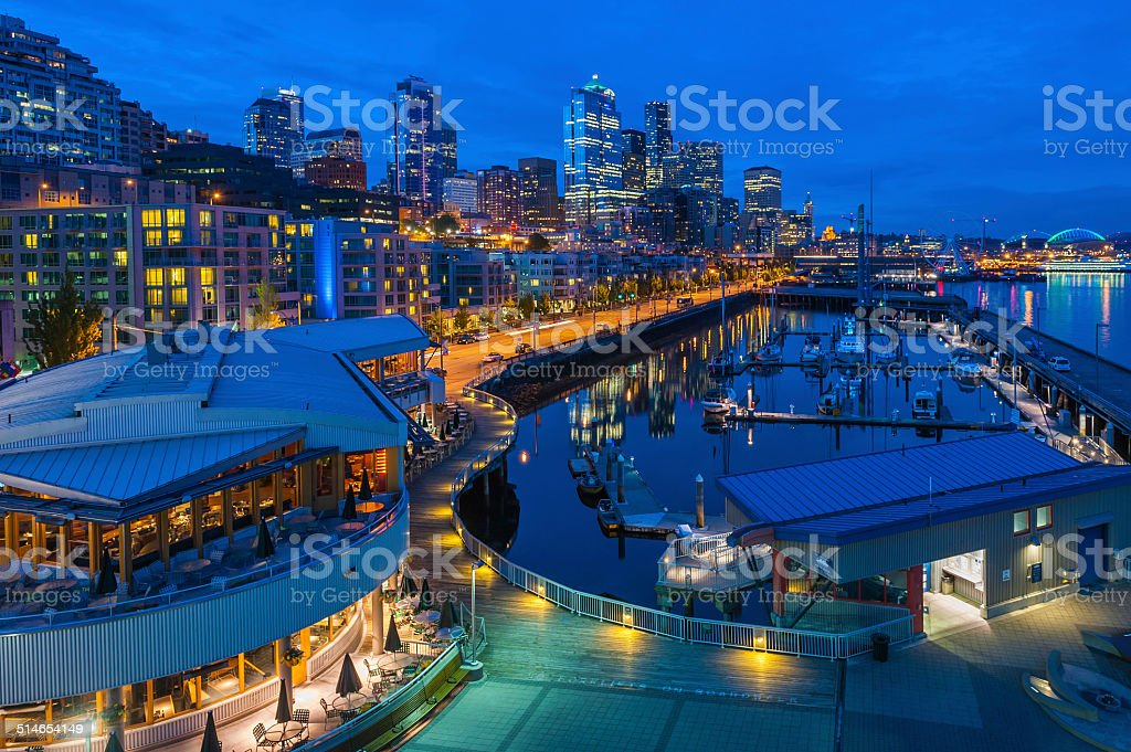 Seattle harborside apartments skyscrapers and waterfront marinas illuminated Washington stock photo