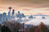 Space Needle and Seattle Skylines in November Fog