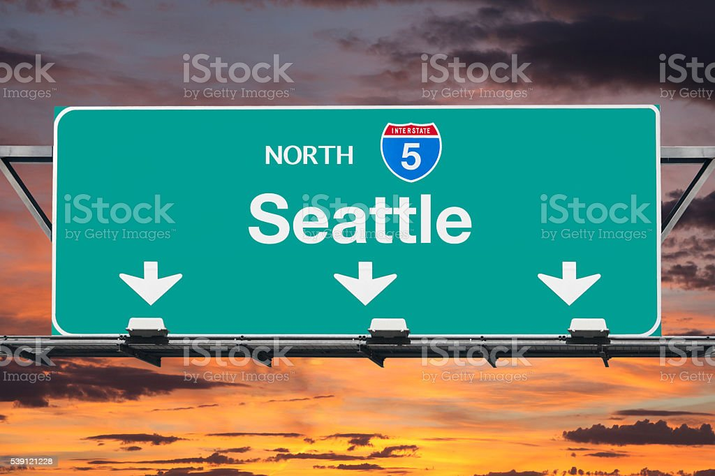 Seattle Interstate 5 North Highway Sign with Sunrise stock photo