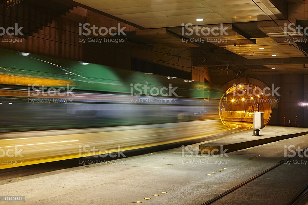 Seattle Metro Bus Zooms Out of Tunnel, Motion Blur royalty-free stock photo