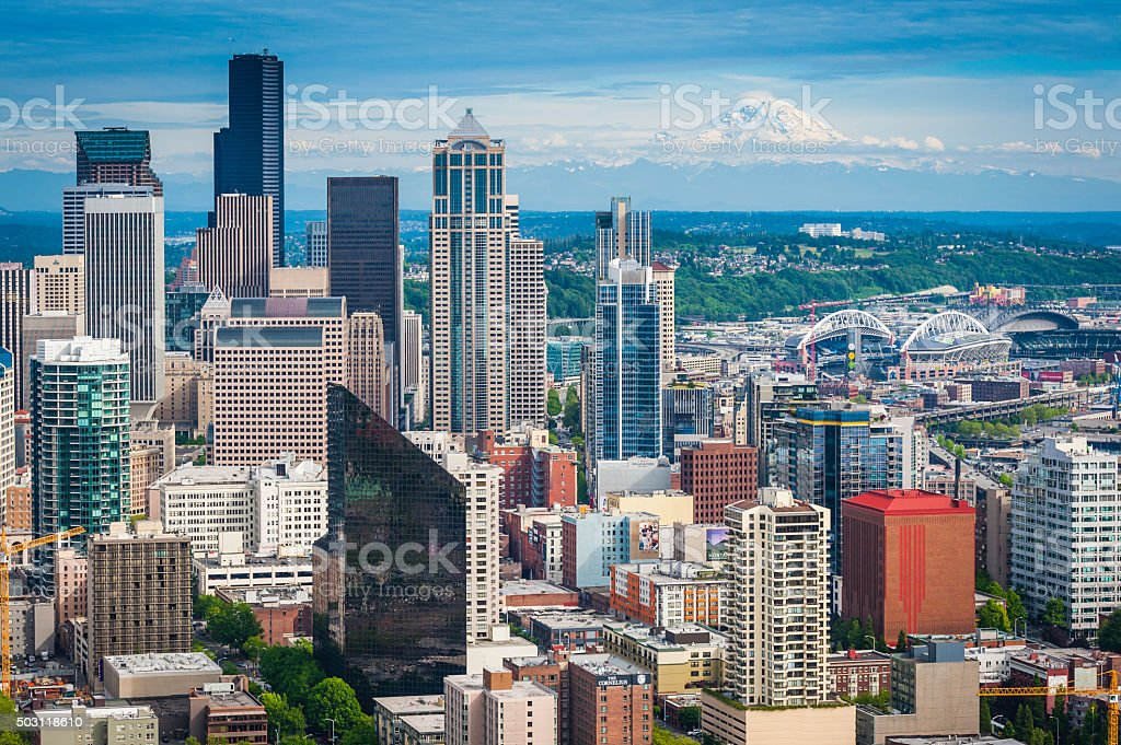 Seattle Mt Rainier snowy summit overlooking downtown skyscrapers Washington USA stock photo