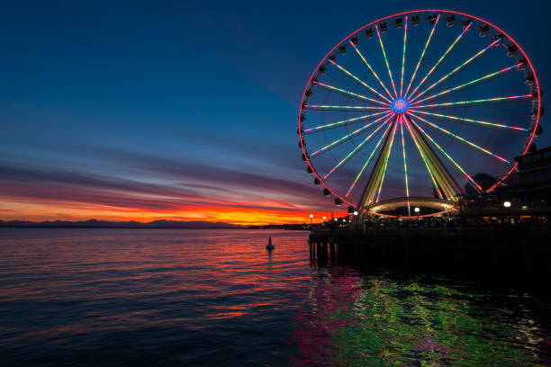 Seattle A vivid sunset on Elliott Bay. ferris wheel stock pictures, royalty-free photos & images