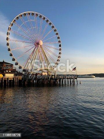 A sunset on Elliott bay with the Ferris wheel.
