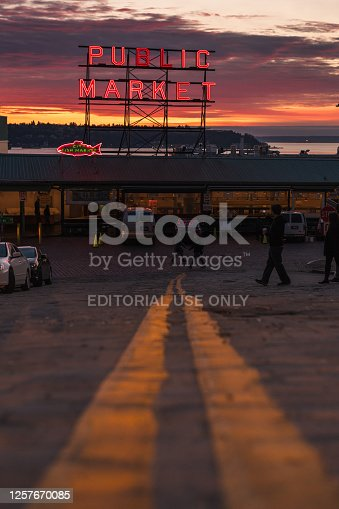 Seattle, USA - Feb  9, 2020: The famous neon public market sign at Pike Place Market at sunset.