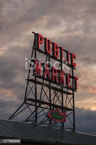 Seattle, USA - April 7, 2019: The famous neon public market sign at Pike Place Market at sunset.