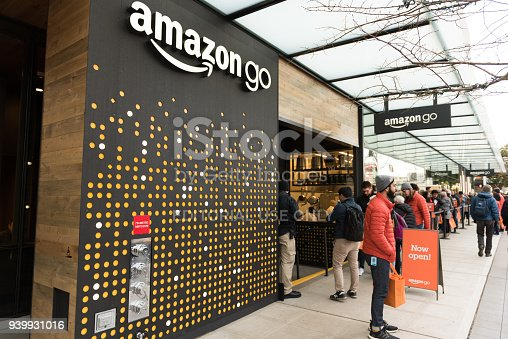 Seattle, USA - Jan 22, 2017: People lined up at amazon go cashier less grocery store early in the day in downtown.