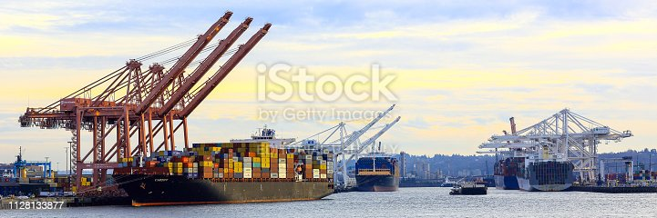 Seattle, Washington, USA - January 26, 2019: Container yard and crane at Seattle seaport during sunset
