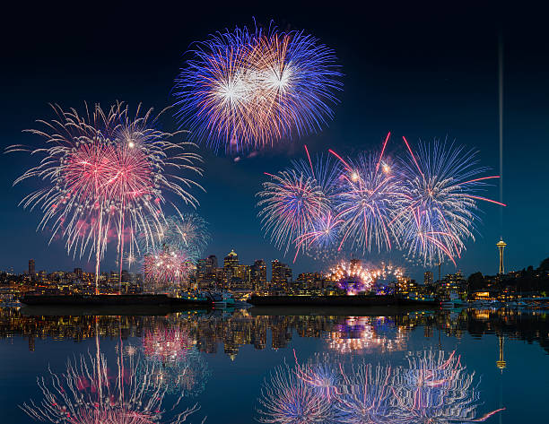Seattle skyline and fireworks with reflections stock photo
