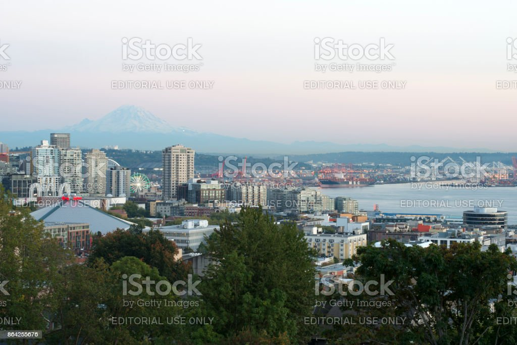 Seattle skyline and harbor view at dusk with Mount Rainier in the distance royalty-free stock photo