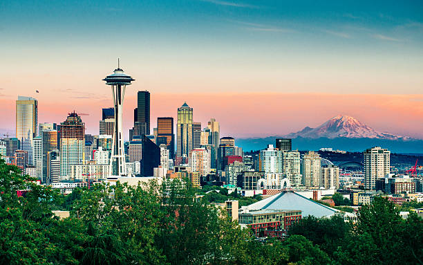 Seattle Skyline and Mount Rainier at Sunset Seattle Skyline and Mount Rainier at Sunset on a clear summer day. mt rainier stock pictures, royalty-free photos & images