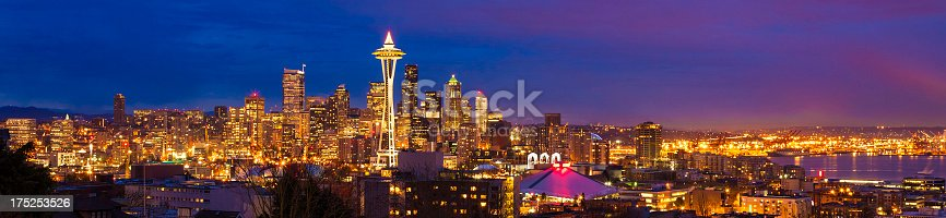 Seattle skyline cityscape night panorama. Christmas decorations and Christmas tree on top of Space Needle.more cityscapes: