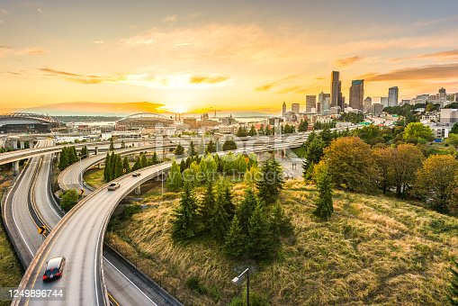 Seattle skylines and Interstate freeways converge with Elliott Bay and the waterfront background of in sunset time, Seattle, Washington State, USA..