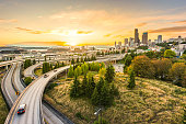 istock Seattle skylines and Interstate freeways converge with Elliott Bay and the waterfront background of in sunset time, Seattle, Washington State, USA. 1249896744