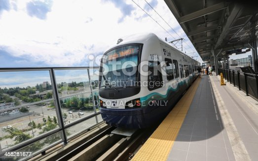 Seattle-Tacoma, Washington, USA - June 29, 2013: Mass transit train pulls into Seattle-Tacoma Airport Station during the afternoon of June 29, 2013. Sound Transit is the main light rail system serving the Seattle Tacoma region.