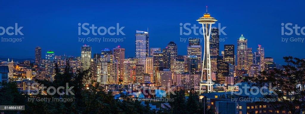 Seattle Space Needle downtown skyscrapers illuminated at dusk Washington panorama stock photo