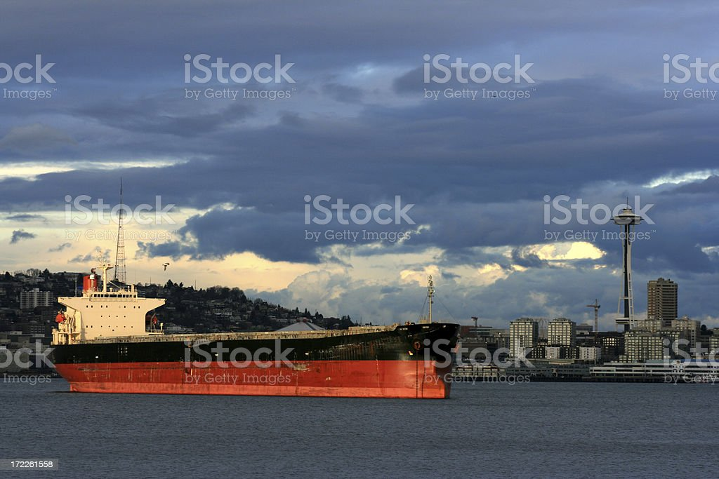 Seattle twilight with Cargo Vessel and Space Needle stock photo