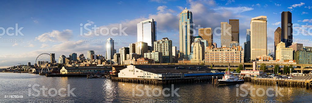 Seattle Washington Skyline At Sunset From Bainbridge Island Ferry Dock. stock photo