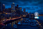Downtown Seattle skyline at dusk. The ferris wheel stands out along the shoreline. Washington State, USA.