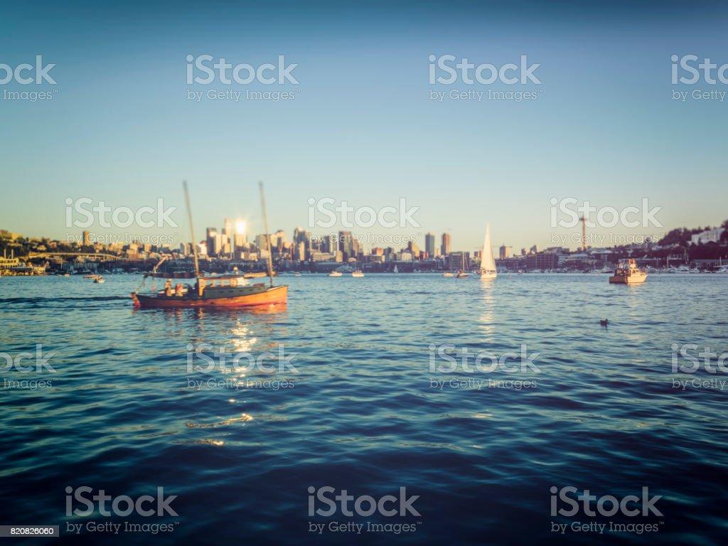 Seattle waterfront skyline with sailboats on Lake Union at sunset stock photo