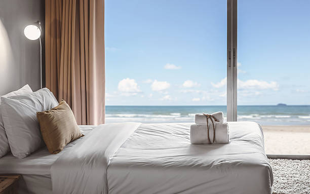 seaview bedroom relaxation in bedroom with seaview luxury hotel room stock pictures, royalty-free photos & images