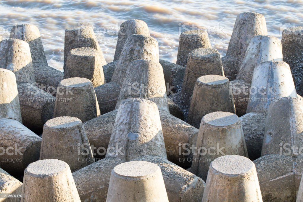 Seawall a stone wall that was constructed around seaside. stock photo