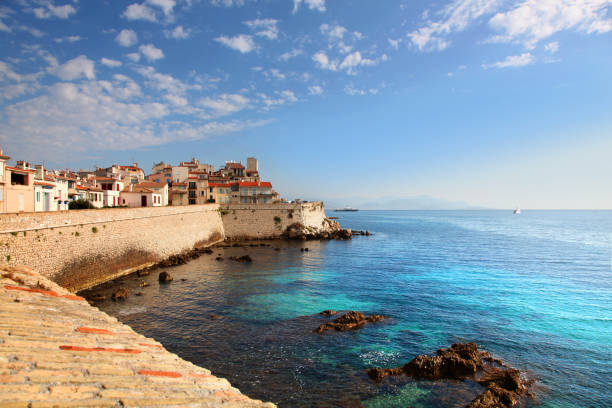 Seawall and harbor in Antibes France stock photo