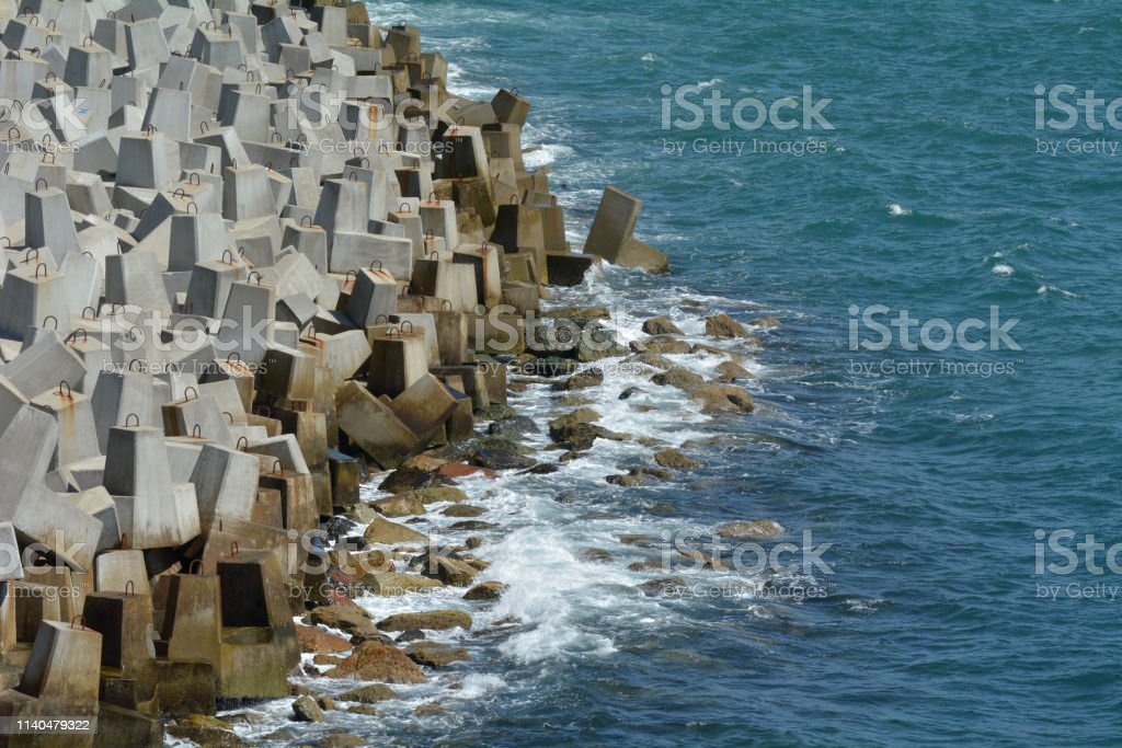 Seawall and ocean waves stock photo