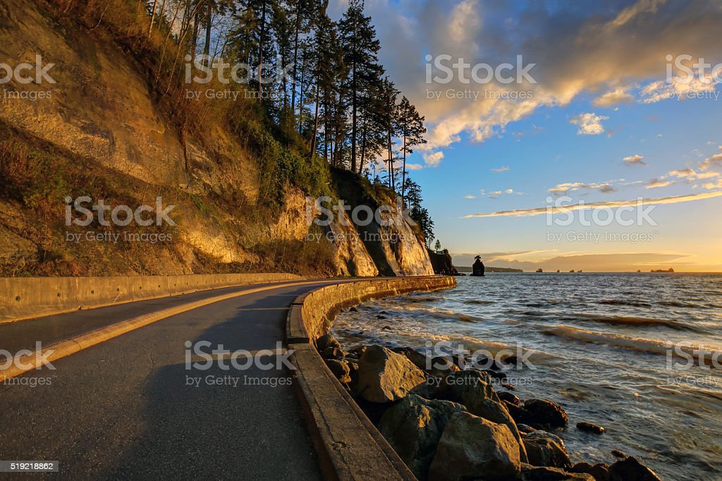 seawall and rock wall at sunset stock photo