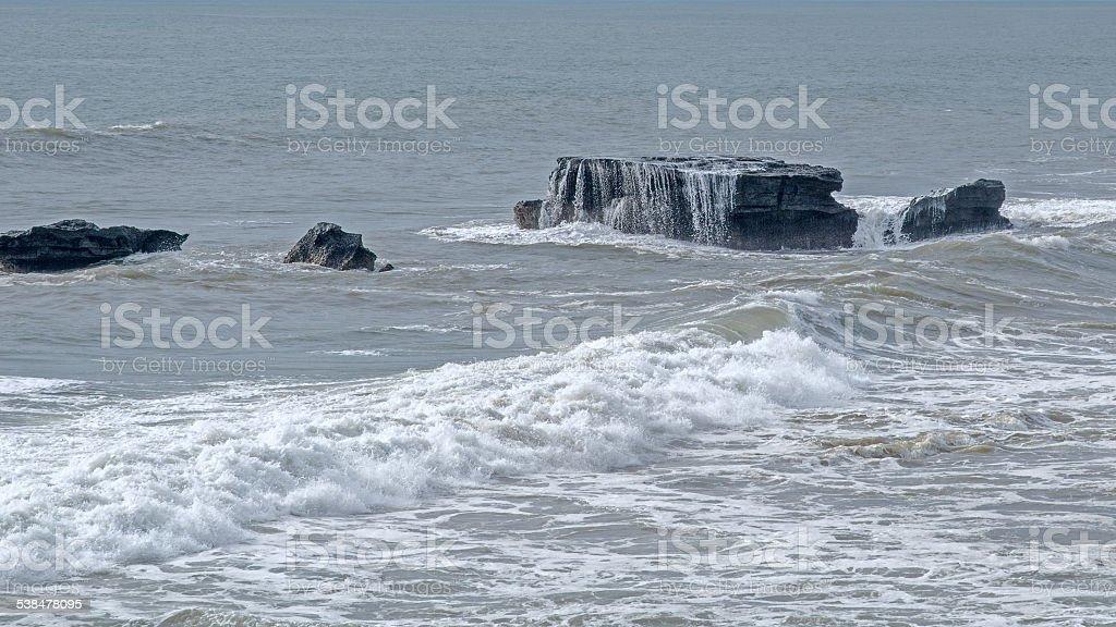 Seawater flows with stones. Uluwatu rocks. Bali. Indonesia stock photo