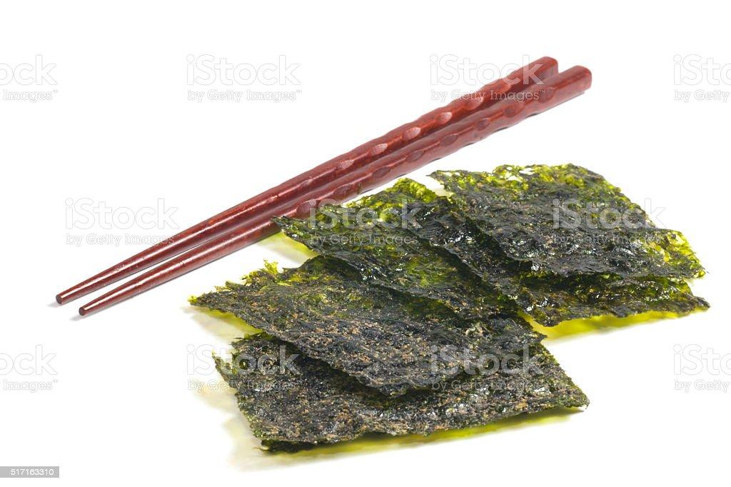Seaweed with chopsticks stock photo